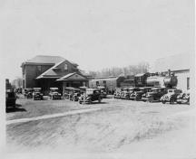 Image of the York Street Train Station showing rolling stock and cars parked in the railway yard, taken circa 1940's; Private Collection