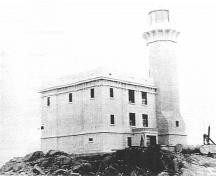 Historical image of the Triple Island Light Tower, 1921.; Parks Canada Agency / Agence Parcs Canada, 1921.