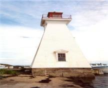 General view of the Mabou Lighthouse showing the west elevation of the tower and the sturdy, solid construction and durable materials including the wood frame, reinforced concrete foundation and clapboard siding, 2002.; Public Works Canada / Ministère des Travaux publics, 2002.