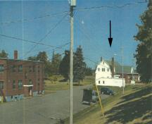 Panoramic view of the Cereal Forage Building (right) and Building 10 (left) showing the compatible scale, materials and style vis-a-vis the remaining adjacent buildings on the farm, 2001.; Agriculture and Agri-Business Canada \ Agriculture et Agroalimentaire Canada, 2001.