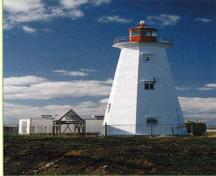 General view of the Flint Island Lighthouse showing the use of white colour for the shaft and contrasting red colour for the lantern.; E.H. Rip Erwin, Lighthouses and Lights of Nova Scotia, [Halifax: Nimbus Publishing Limited, 2003], pp.136, n.d.