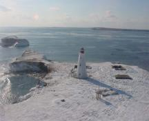 Aerial view of the Flint Island Lighthouse against a winter's day backdrop.; Department of Fisheries & Oceans Canada/Département de pêches et océans Canada, n.d.