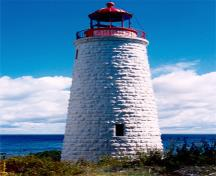 General view of the Griffith Island lighthouse showing its tall, round, slightly tapered form corbelled at the top to form a gallery and base for the lantern, 1990.; Canadian Coast Guard / Garde côtière canadienne, 1990.