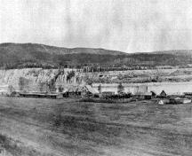 Historical image of Fort Alexandria showing the original buildings (now demolished) on the west side of the Fraser River in the Cariboo District of British Columbia.; British Columbia Archives / Archives de la Colombie Britannique, #F-05775, n.d.