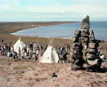 General view of the Arvia'juaq and Qikiqtaarjuk sites demonstrating the continued use of these sites for cultural, spiritual and economic purposes by the Inuit.; Parks Canada / Parcs Canada, n.d.
