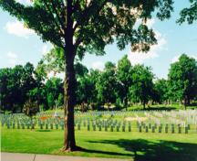 General view of the military section of the Beechwood Cemetery showing the Cross of Sacrifice erected by The Commonwealth War Graves Commission and its central placement within the military cemetery, 2000.; Parks Canada Agency / Agence Parcs Canada, R. Godspeed, 2000.