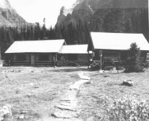 Exterior photograph showing the simple massing of the rectangular building and its medium-pitched roof.; Parks Canada