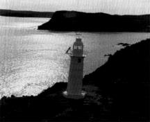 General view of the lighttower at King's Cove Head, showing the overall composition and appearance of the lighthouse isolated on a headland jutting into a bay on the exposed Newfoundland coast, 1989.; Canadian Coast Guard/Garde côtière canadienne, 1989.