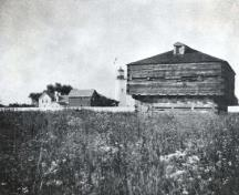 Historic image of the blockhouse, including the buildings that once stood near the lighthouse.; Parks Canada Agency / Agence Parcs Canada
