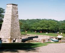 View of the chimney and remains of the lower forge at Forges du Saint-Maurice National Historic Site of Canada, 2002.; Parks Canada Agency / Agence Parcs Canada, E. Kedl, 2002.