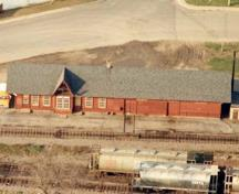 Arial view of the Canadian Pacific Heritage Railway Station, showing its simple, domestic design, with features typical of QMO&O stations.; Parks Canada Agency/Agence Parcs Canada