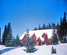 Panoramic view of the Skoki Ski Lodge showing its relationship with, and viewscapes to and from: the Skoki Valley, the surrounding mountain peaks, and the backcountry of Banff National Park, 1965.; Parks Canada Agency / Agence Parcs Canada, 1965