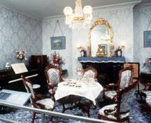Interior view of the Sir George-Étienne Cartier National Historic Site of Canada, showing the surviving original interior decoration with its architectural woodwork and its distinction between private and public rooms, 1989.; Parks Canada Agency/Agence Parcs Canada, 1989.