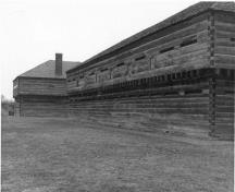 Rear view of Blockhouse 2, showing the long, rectangular, two-storey massing, circa 1989.; Parks Canada Agency / Agence Parcs Canada, circa 1989.
