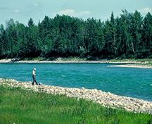 General view of Rocky Mountain House emphasizing its location adjacent to Brierly Rapids on the North Saskatchewan River, 1982.; Parks Canada Agency / Agence Parcs Canada, F. Cattroll, 1982.