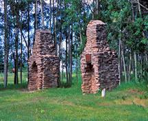 Detail view of the Rocky Mountain House chimneys showing archaeological remains of the four post sites, 2002.; Parks Canada Agency / Agence Parcs Canada, K. Dahlin, 2002.