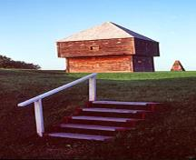 General view of Fort Edward showing the blockhouse and cairn in the background, emphasizing the cultural landscape of Fort Edward, 1983.; Parks Canada Agency / Agence Parcs Canada, F. Cattroll, 1983.
