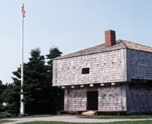 General view of the St. Andrews Blockhouse, showing the symmetrical articulation with a central door and regular window openings, 1982.; Parks Canada Agency/Agence Parcs Canada, F. Cattroll, 1982.