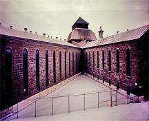 General view of the north wing (left) and Northeast wing (right) of the Saint-Vincent-de-Paul Penitentiary showing the caged gate apertures.; Parks Canada Agency / Agence Parcs Canada, n.d.