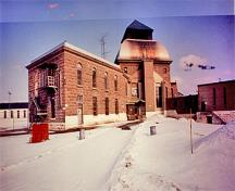 General view of the joining point of the south wing and the dome of Saint-Vincent-de-Paul Penitentiary showing its abundant use of stone materials and their skillful craftsmanship.; Parks Canada Agency / Agence Parcs Canada, n.d.