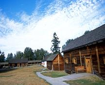 General view of the Fort Langley National Historic Site of Canada showing the footprints as well as remnants and reconstructed profiles of buildings and structures inside the palisades of the fort, 2005.; Parks Canada Agency / Agence Parcs Canada, J. Gordon, 2005.