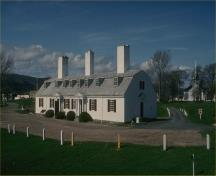 General view of the Fort Anne National Historic Site of Canada  showing the surviving remnants of the original officers' quarters, namely the footprint and form of the building, and the original fireplaces, 1994.; Parks Canada / Parcs Canada 1994