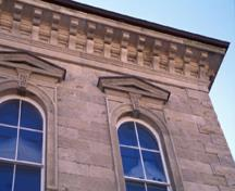 Detailed view of Guelph City Hall, showing its Italianate detailing, including quoins at openings and corners, 1995.; Parks Canada Agency/Agence Parcs Canada, J. Butterill, 1995.