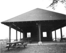 General view of the Pavilion's east elevation and the prominent low-hipped roof, 1984.; Parks Canada Agency/Agence Parcs Canada, R. Sutart, 1984.