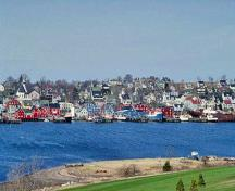 Panoramic view of Old Town Lunenburg Historic District showing the unity and cohesiveness created by the predominance of wood construction and exterior finishes among all building types and styles, 1993.; Parks Canada Agency/Agence Parcs Canada, 1993.