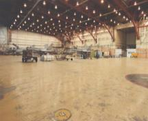 View of the interior of Hangar 1, showing its structure and interior finishes, including the Warren Truss system and the reinforced concrete slab, 2000.; Department of National Defence / ministère de la Défense nationale, 2000.
