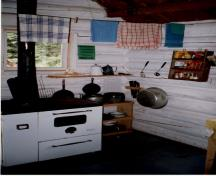 Interior view of the Byng Warden Patrol Cabin, showing the walls of horizontally laid peeled logs, 1997.; Parks Canada Agency / Agence Parcs Canada, 1997.