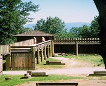 General view of the Northeast Bastion showing its walls on the second level that contain small windows and two doors which give access to the galleries on the north and west walls, 2002.; Parks Canada Agency / Agence Parcs Canada, M. Trepanier, 2002.