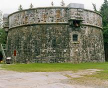 General view of the Prince of Wales Tower showing the massive circular walls built of rubble masonry and its exterior wall which inclines slightly inwards as it rises, 1995; Parks Canada Agency / Agence Parcs Canada, 1995.