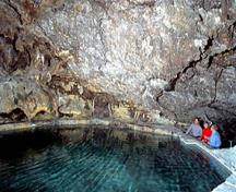 General view of the interior of the cave and Basin pool showing its warm mineral waters, 2002.; Agence Parcs Canada / Parks Canada Agency, K. Dahlin, 2002