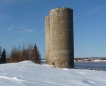 Situated near the office, these silos were built in 1932 to load Hillsborough's unusally pure and white rock gypsum into ocean going ships on the Petitcodiac water front.; Village of Hillaborough