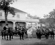Street scene in Hillsborough circa 1907 looking southeast. Orange parade forming up in front of Captain Wood's house.; Village of Hillsborough