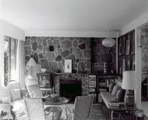 Interior view of the Binning Residence, showing the generously proportioned living-dining area dominated by a Cypress Creek fieldstone fireplace wall, 1997.; Parks Canada Agency / Agence Parcs Canada, S.D. Bronson, 1997.