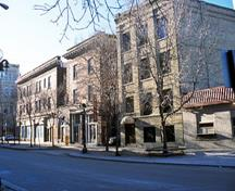General view of buildings in the Exchange District National Historic Site of Canada showing popular turn-of-the-century architectural styles including the Richardsonian Romanesque, Italianate, Beaux-Arts, and the Chicago School style, 2003.; Parks Canada Agency / Agence Parcs Canada, K. Dahlin, 2003.