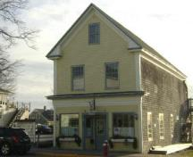 This photograph shows the contextual view of the Odell-Connors Building, 2009; Town of St. Andrews