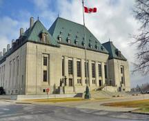 "General view of the Supreme Court Building showing the severe classical granite-clad base and the borrowed ""chateau"" roof, 2011.; Parks Canada Agency / Agence Parcs Canada, M. Therrien, 2011."