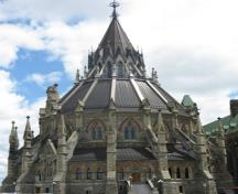 Exterior view of the Parliament Library showing its High Victorian Gothic Revival style, including its circular plan, chapter house-inspired design, 2010.; Parks Canada / Parcs Canada, Catherine Beaulieu 2010.
