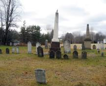 This image shows obelisk tombstones amongst smaller tombstones; Village of Gagetown