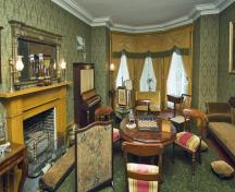 Interior view of Bellevue House showing the furniture and furnishings inside the house that are evidence of its occupancy by Sir John A. Macdonald, 2007.; Parks Canada Agency / Agence Parcs Canada, John McQuarrie, 2007.