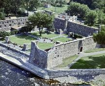 Aerial view of Fort Chambly showing the central courtyard surrounded on all four sides by stone buildings. 1965.; Parks Canada Agency / Agence Parcs Canada, 1965.
