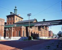General view of Gooderham and Worts Distillery showing the existing spatial arrangement of the buildings on the site arrayed along lanes and streets.; Parks Canada Agency / Agence Parcs Canada.