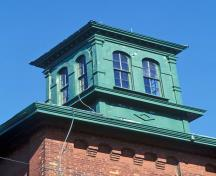 Detail view of Gooderham and Worts Distillery showing coordinated palette of material and paint colours throughout.; Parks Canada Agency / Agence Parcs Canada.