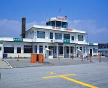 General view of Toronto Island Airport Terminal Building showing its two-storey, rectangular massing.; Parks Canada Agency / Agence Parcs Canada.