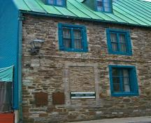 Detail view of Maillou House showing the rough-cut stone construction with dressed stone trim.; Parks Canada Agency / Agence Parcs Canada.