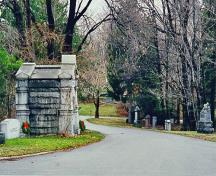 General view of Mount Pleasant Cemetery, showing the winding paths, avenues, and bridges in their routes and extent.; Parks Canada Agency / Agence Parcs Canada.