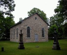 The façade of Old Stone Church, showing the fieldstone and low-pitched roof, 2006.; Parks Canada Agency / Agence Parcs Canada, 2006.